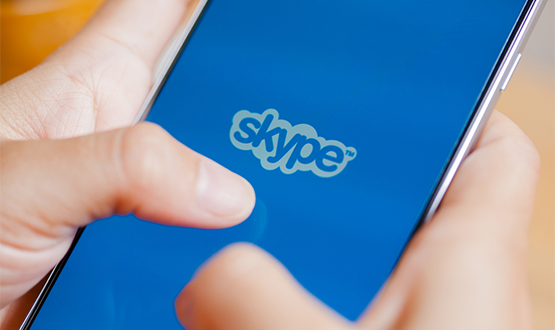 A person on their phone using Skype