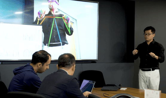 Dr. Wei Fan of Tencent and Dan Vahdat of Medopad conduct a demo of their Parkinson's assessment AI