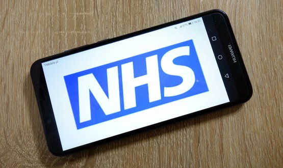 NHS logo on smartphone